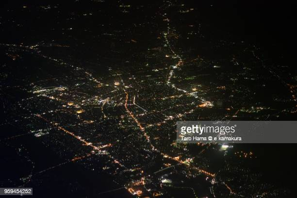 Center of Takaoka city in Toyama prefecture in Japan night time aerial view from airplane