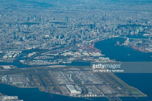 Center of Tokyo city and Tokyo Haneda International Airport daytime aerial view from airplane