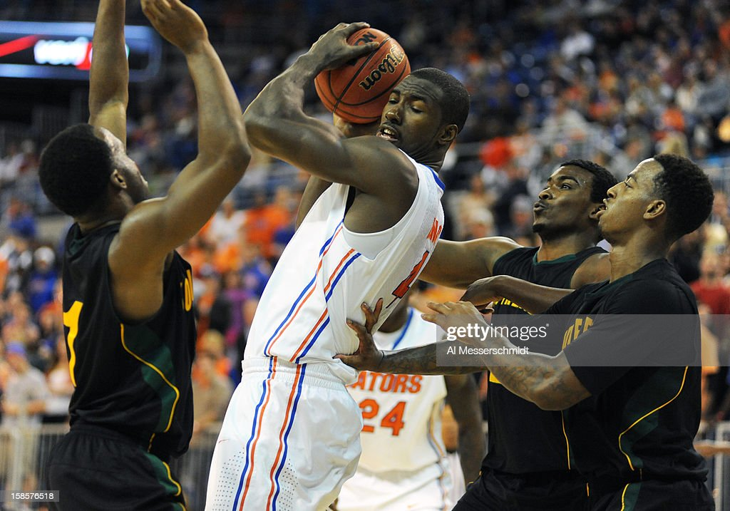 Center Patric Young #4 of the Florida Gators grabs a rebound against the Southeastern Louisiana Lions December 19, 2012 at Stephen C. O'Connell Center in Gainesville, Florida. The Gators won 82 - 43.