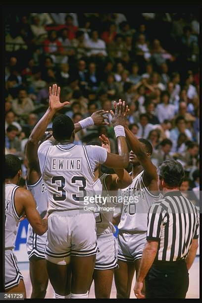 Center Patrick Ewing of the Georgetown Hoyas high fives his teammates during a game Mandatory Credit Allsport /Allsport