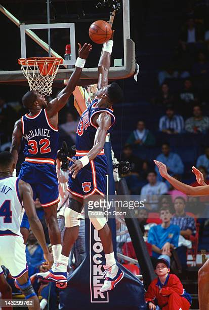 Center Patrick Ewing of the New York Knicks goes up to grab a rebound against the Washington Bullets during an NBA basketball game circa 1988 at the...