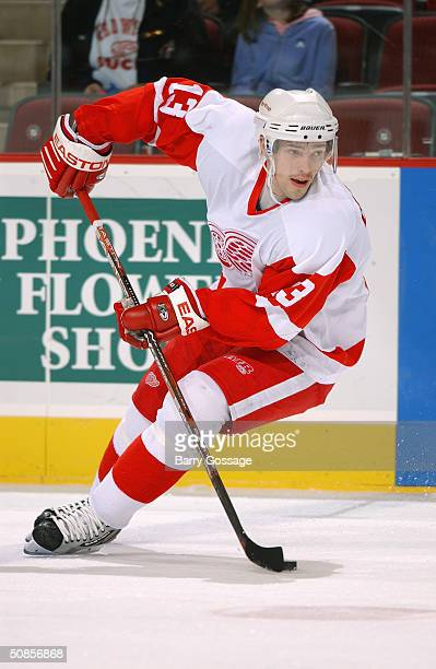 Center Pavel Datsyuk of the Detroit Red Wings advances the puck against the Phoenix Coyotes during the game at the Glendale Arena on March 18 2004 in...