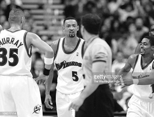 Center Post Photo by Rich Lipski Wizards' forward Juwan Howard yells at referee Tim Donaghy as Wizards teammates converge on Howard to retrain him...