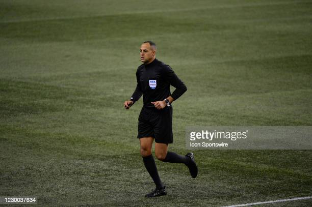 Center referee Ismail Elfath heads to the replay monitor during a Western Conference MLS Final between the Seattle Sounders and Minnesota United on...
