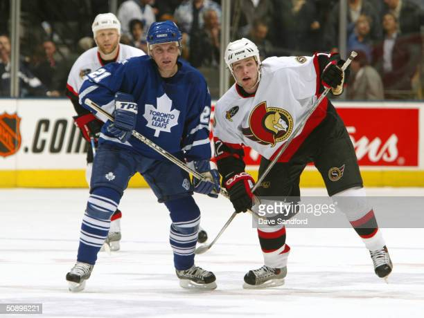 Center Robert Reichel of the Toronto Maple Leafs and center Mike Fisher of the Ottawa Senators jostle for position during game seven of the eastern...