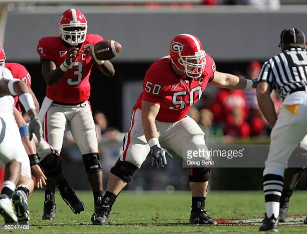 Center Russ Tanner of the Georgia Bulldogs pass blocks for quarterback DJ Shockley against the Kentucky Wildcats at Sanford Stadium on November 19...