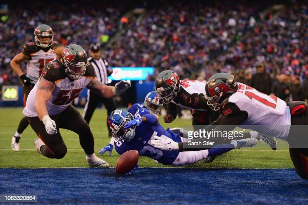 Center Ryan Jensen quarterback Jameis Winston and wide receiver Mike Evans of the Tampa Bay Buccaneers recover a fumbled ball for touchdown in the...