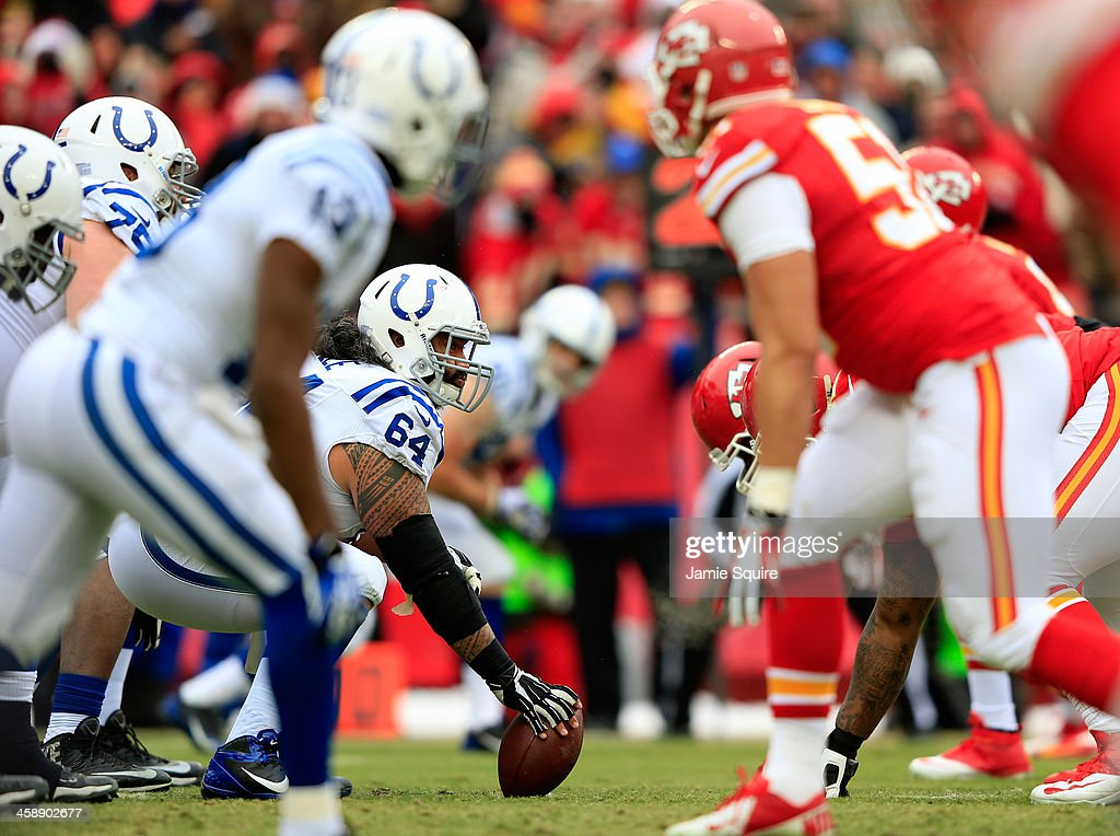 Center Samson Satele #64 of the Indianapolis Colts prepares to snap the ball during the game against the Kansas City Chiefs at Arrowhead Stadium on December 22, 2013 in Kansas City, Missouri.