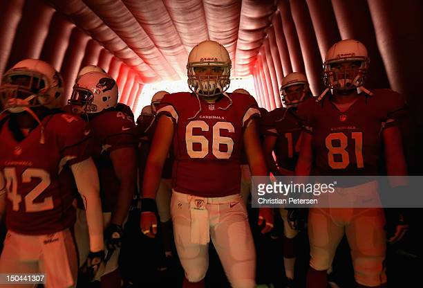 Center Scott Wedige of the Arizona Cardinals waits to take the field prior to the NFL preseason game against the Oakland Raiders at the University of...
