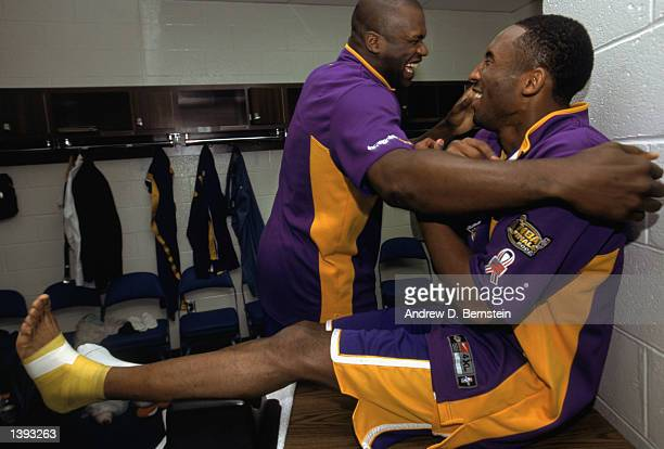 Center Shaquille O'Neal of the Los Angeles Lakers jokes with guard Kobe Bryant in the locker room before Game Four of the 2002 NBA Finals against the...