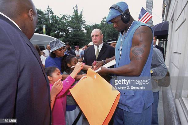 Center Shaquille O'Neal of the Los Angeles Lakers signs autographs outside the team's hotel the day after winning Game Four of the 2002 NBA Finals...