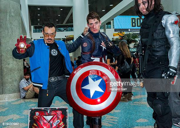 Center Shelby Avila as Captain America with Cosplayer Tony Stark and Bucky at Los Angeles Convention Center on October 30 2016 in Los Angeles...