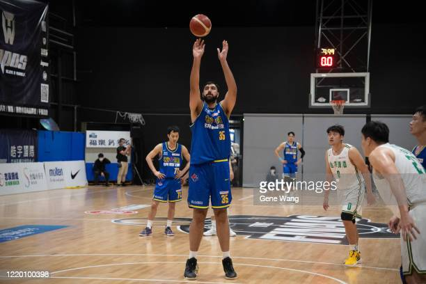 Center Sim Bhullar of Yulon Luxgen Dinos attempt to shoot the free throw during the SBL Finals Game One between Taiwan Beer and Yulon Luxgen Dinos at...