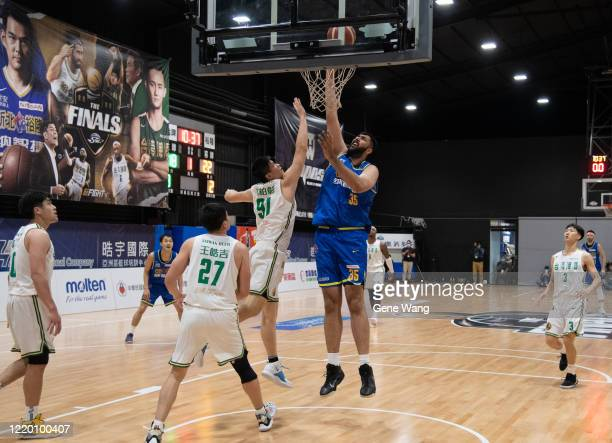 Center Sim Bhullar of Yulon Luxgen Dinos made a layup shot during the SBL Finals Game One between Taiwan Beer and Yulon Luxgen Dinos at Hao Yu...