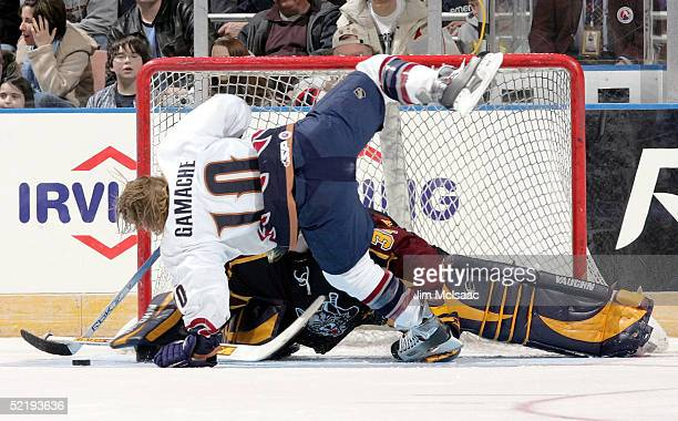 Center Simon Gamache of the Milwaukee Admirals is stopped by goalie Kari Lehtonen of the Chicago Wolves during the breakaway relay at the American...