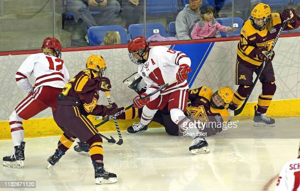 Center Sophia Shaver and defender Maddie Rolfes of the Wisconsin Badgers battle wing Nicole Schammel Grace Zumwinkle and center Taylor Wente of the...