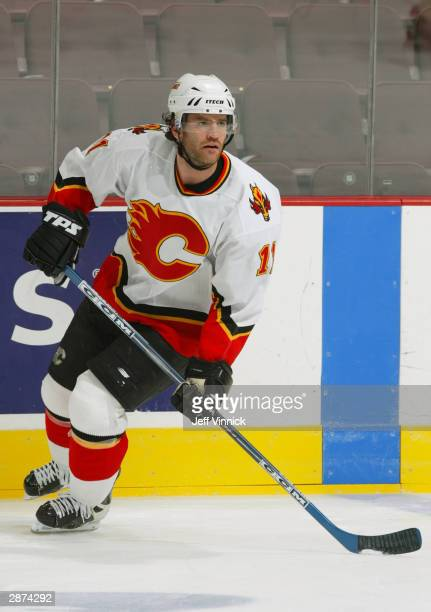 Center Stephane Yelle of the Calgary Flames practices for the game against the Vancouver Canucks at General Motors Place on December 4, 2003 in...