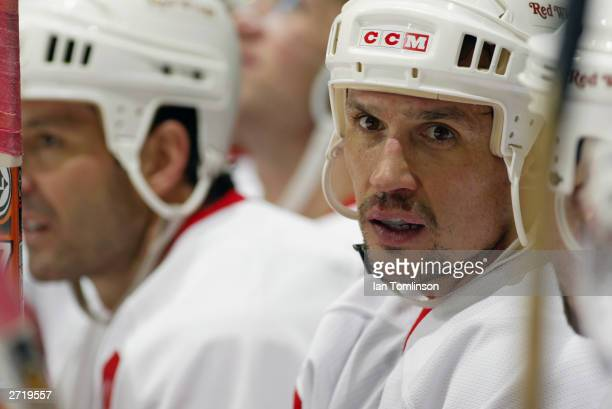 Center Steve Yzerman of the Detroit Red Wings is with his teammates on the bench during the game against the Calgary Flames on November 4 2003 at The...