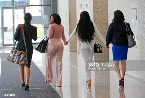 Center, supporters of singer R. Kelly, Joycelyn Savage and Azriel Clary and their attorneys arrive for the arraignment of the singer at the Dirksen...