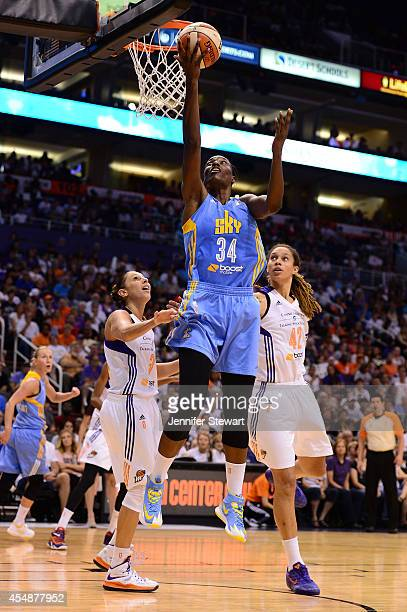 Center Sylvia Fowles of the Chicago Sky lays up the ball against guard Diana Taurasi and center Brittney Griner of the Phoenix Mercury in the second...