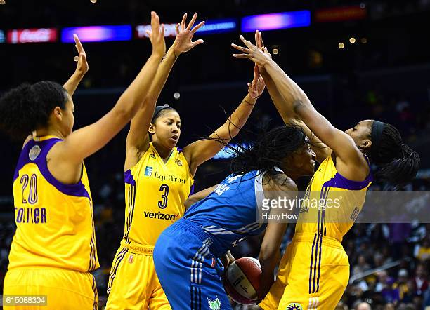 Center Sylvia Fowles of the Minnesota Lynx is surrounded by forward Nneka Ogwumike forward Candace Parker and guard Kristi Toliver of the Los Angeles...