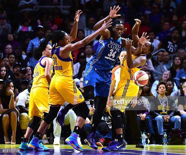 Center Sylvia Fowles of the Minnesota Lynx loses the ball between forward Nneka Ogwumike and guard Chelsea Gray of the Los Angeles Sparks during an...