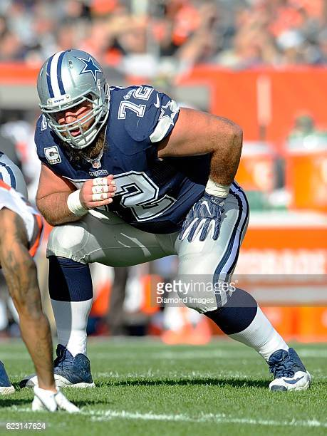 Center Travis Frederick of the Dallas Cowboys awaits the snap from his position on an extra point attempt during a game against the Cleveland Browns...