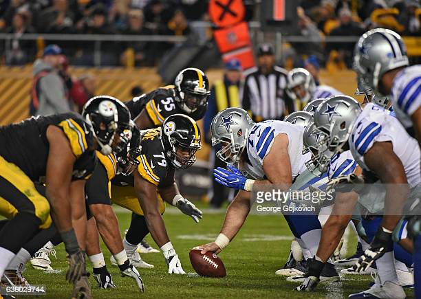 Center Travis Frederick of the Dallas Cowboys looks across the line of scrimmage at defensive lineman Javon Hargrave of the Pittsburgh Steelers...