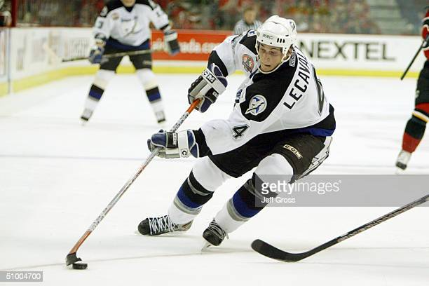 Center Vincent Lecavalier of the Tampa Bay Lightning advances the puck against the Calgary Flames in Game three of the NHL Stanley Cup Finals at the...