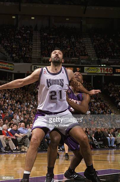 Center Vlade Divac of the Sacramento Kings boxes out forward Alton Ford of the Phoenix Suns during the NBA game at Arco Arena in Sacramento...