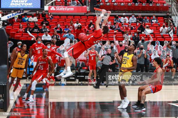 Center Vladislav Goldin of the Texas Tech Red Raiders dunks the ball during the second half the college basketball game against the Grambling State...