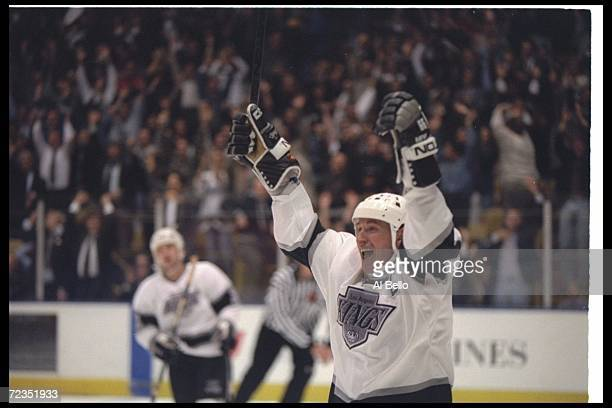 Center Wayne Gretzky of the Los Angeles Kings celebrates after scoring goal 802, breaking Gordie Howe's all-time scoring record of 801, during the...