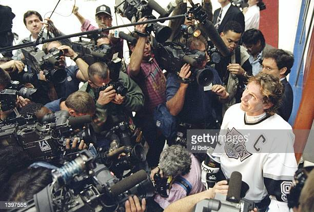 Center Wayne Gretzky of the Los Angeles Kings is surrounded by photographers after breaking the alltime NHL goal scoring record in the game against...
