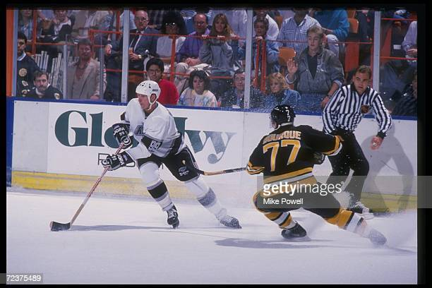Center Wayne Gretzky of the Los Angeles Kings skates past defenseman Ray Bourque of the Boston Bruins during the Kings game versus the Bruins at the...