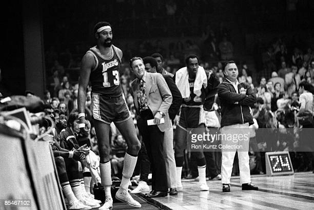 Center Wilt Chamberlain of the Los Angeles Lakers waits to reenter the contest during a game on March 22 1972 against the Cleveland Cavaliers at the...
