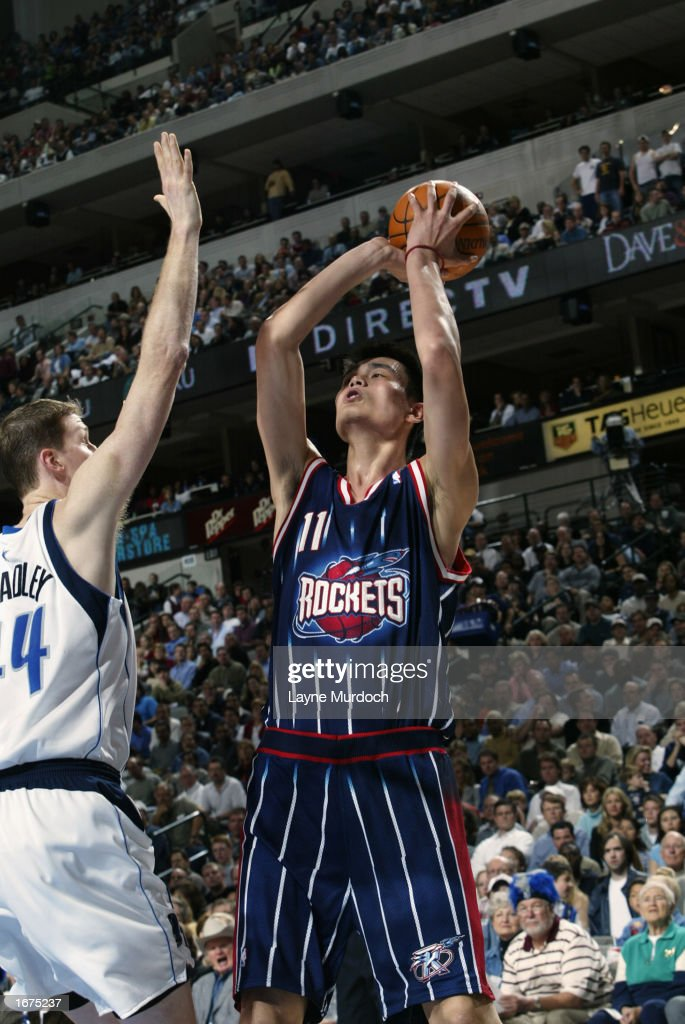 Center Yao Ming #11 of the Houston Rockets shoots over center Shawn Bradley #44 of the Dallas Mavericks during the game at American Airlines Center on November 21, 2002 in Dallas, Texas. The Mavericks won 103-90.