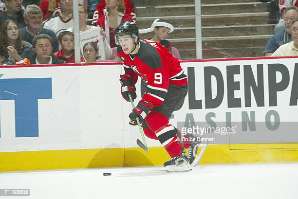 Center Zach Parise of the New Jersey Devils advances the puck against the Carolina Hurricanes in game four of the Eastern Conference Semifinals...