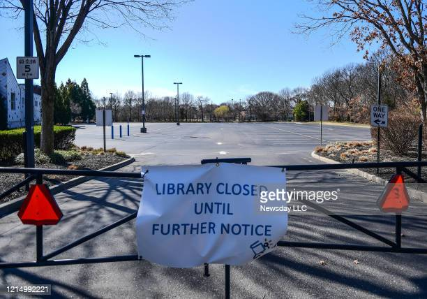 Sign in front of Middle Country public Library in Centereach New York says that the library is closed until further notice during the coronavirus...