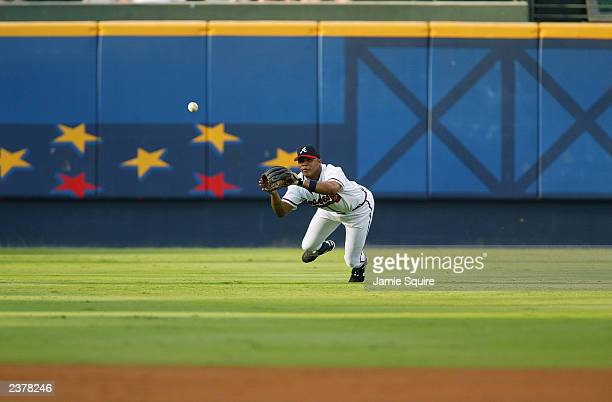 Centerfielder Andruw Jones of the Atlanta Braves dives for a ball during the MLB game against the Milwaukee Brewers at Turner Field on July 31 2002...