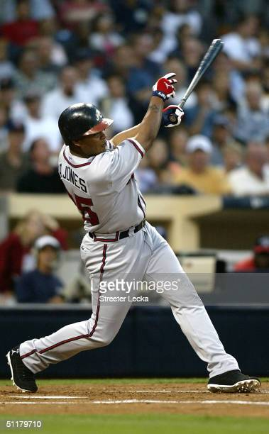 Centerfielder Andruw Jones of the Atlanta Braves hits a home run in the second inning of the game against the San Diego Padres on August 16 2004 at...