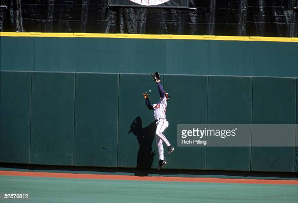 Centerfielder Andruw Jones of the Atlanta Braves jumps for a ball against the Philadelphia Phillies at Veterans Stadium on April 12 1998 in...
