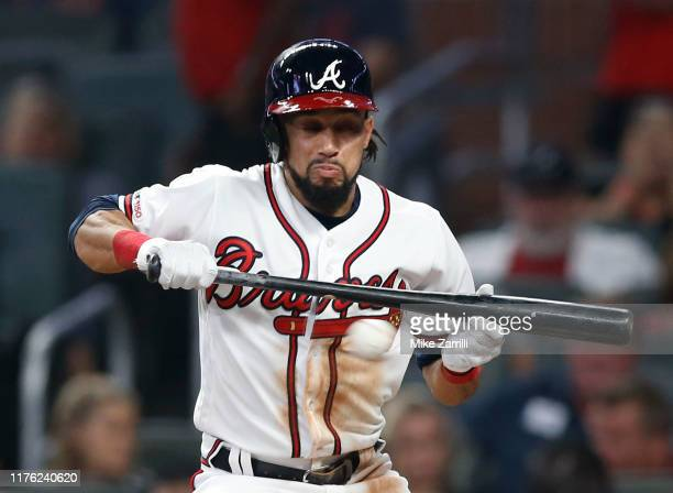 Centerfielder Billy Hamilton of the Atlanta Braves pulls back on a bunt attempt on a close, inside pitch in the fourth inning during the game against...