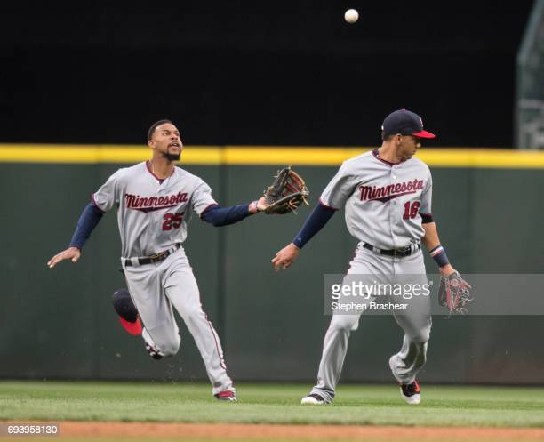Centerfielder Byron Buxton of the Minnesota Twins catches a fly ball hit by Ben Gamel of the Seattle Mariners as shortstop Ehire Adrianza of the...