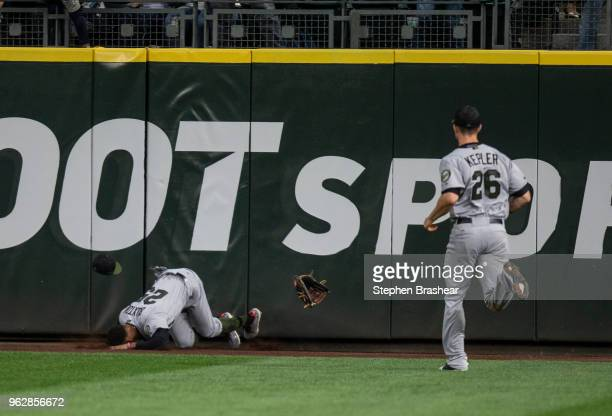 Centerfielder Byron Buxton of the Minnesota Twins hits the warning track after trying to catch a tworun home run ball hit by Nelson Cruz of the...