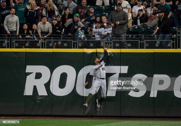 Centerfielder Byron Buxton of the Minnesota Twins leaps into the outfield wall to try to get get to a tworun home run hit by Nelson Cruz of the...