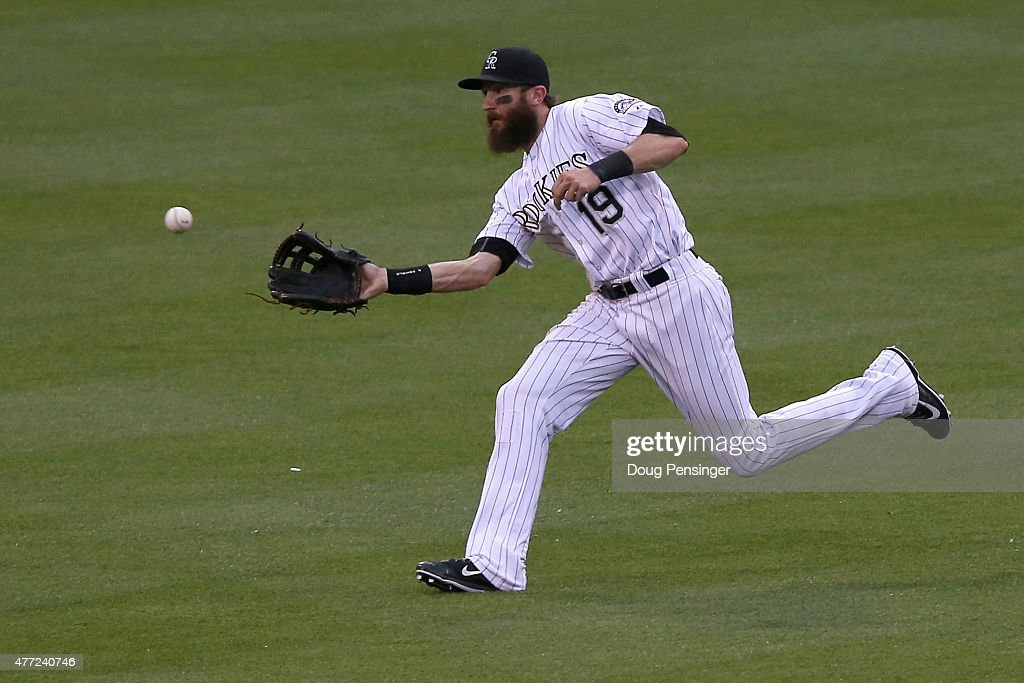 Centerfielder Charlie Blackmon #19 of the Colorado Rockies makes a catch against the St. Louis Cardinals at Coors Field on June 10, 2015 in Denver, Colorado. The Cardinals defeated the Rockies 4-2.