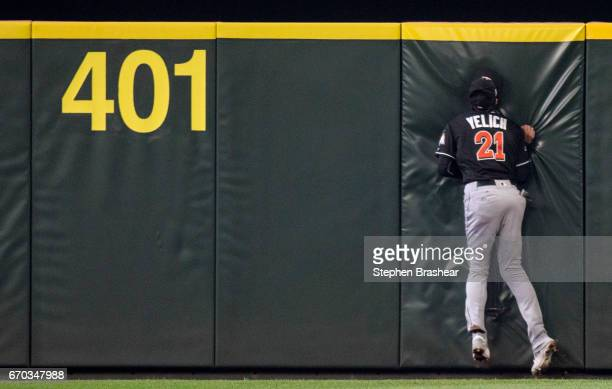 Centerfielder Christian Yelich of the Miami Marlins hits the wall after making a catch on a ball hit by Jarrod Dyson of the Seattle Mariners during...