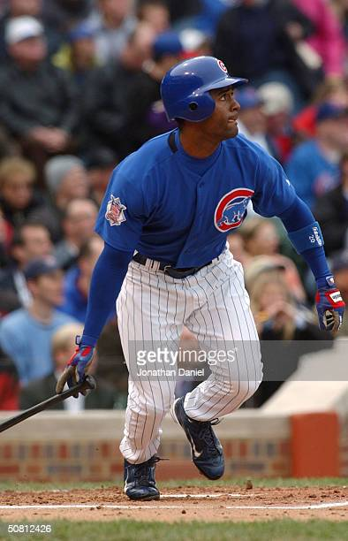 Centerfielder Cory Patterson of the Chicago Cubs hits a threerun double in the second inning against the Colorado Rockies on May 7 2004 at Wrigley...