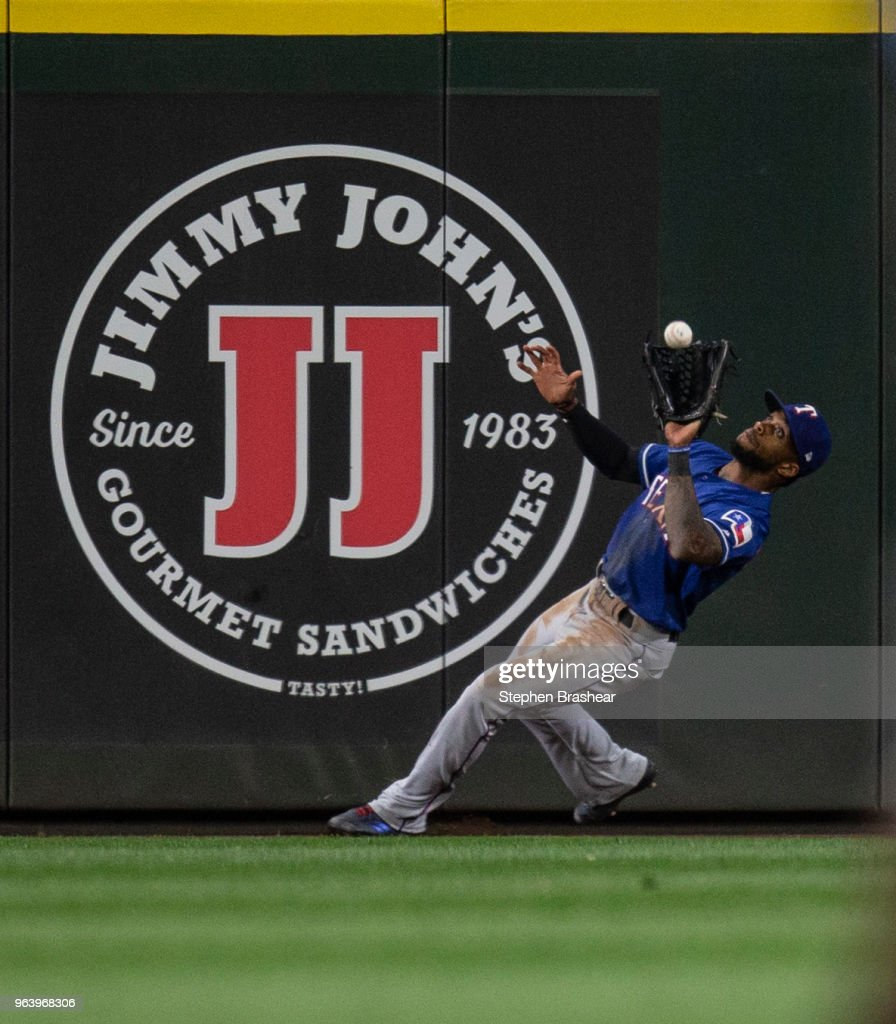 Centerfielder Delino DeShields #3 of the Texas Rangers makes a catch at the warning track on a ball hit y Gordon Beckham #1 of the Seattle Mariners during the eighth inning of a game at Safeco Field on May 30, 2018 in Seattle, Washington.