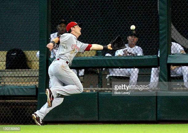 Centerfielder Drew Stubbs of the Cincinnati Reds just misses a deep fly ball off the bat of Jimmy Paredes of the Houston Astros in the second inning...